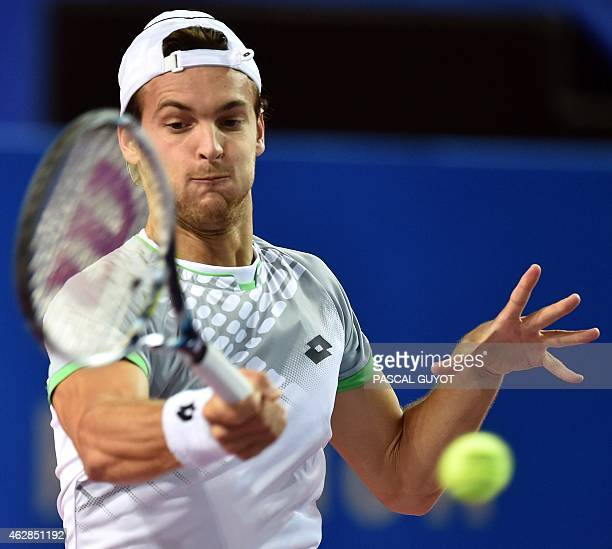 Portuguese tennis player Joao Sousa returns the ball to German tennis player Philipp Kohlschreiber during their tennis match at the Open Sud de...