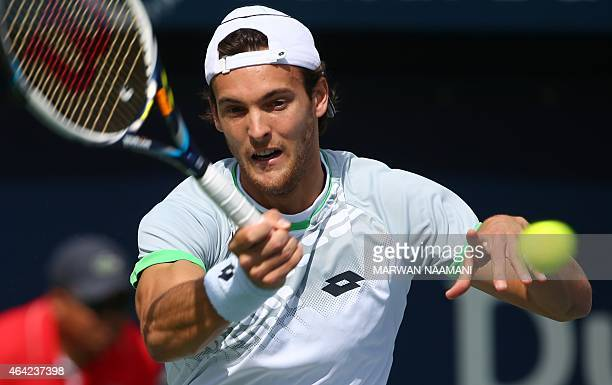 Portuguese tennis player Joao Sousa returns the ball to Irish James McGee during their tennis match on the first day of the ATP Dubai Duty Free...