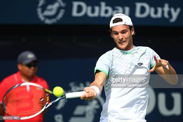 Portuguese tennis player Joao Sousa returns the ball to Irish James McGee during their match in the first day of the ATP Dubai Duty Free Tennis...