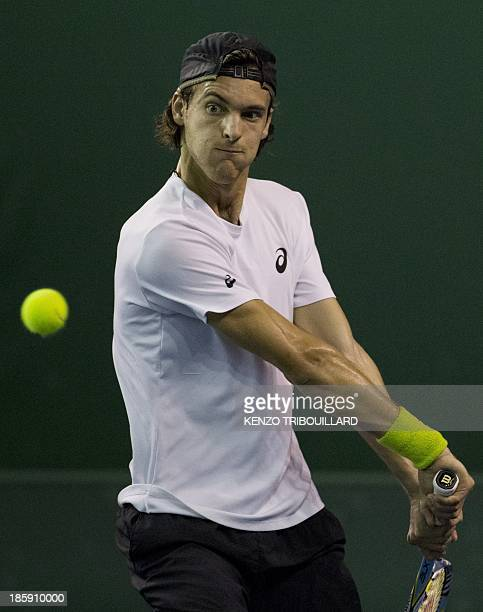 Portuguese tennis player Joao Sousa returns the ball to Victor Hanescu of Romania during their match at the ninth and final ATP World Tour Masters...