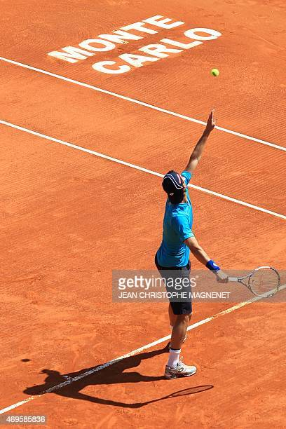 Portuguese tennis player Joao Sousa serves to French tennis player Edouard RogerVasselin during their MonteCarlo ATP Masters Series Tournament tennis...