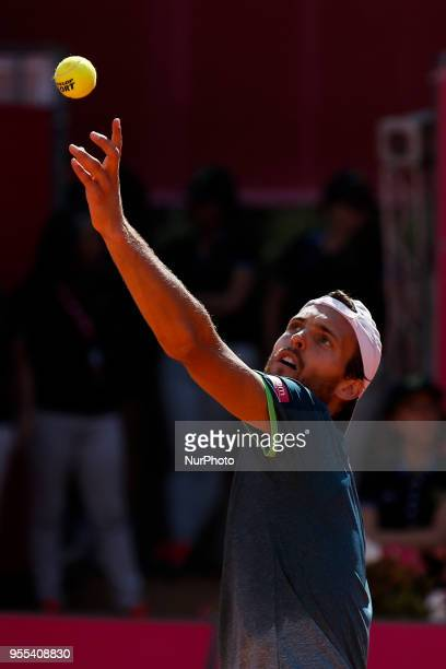 Portuguese tennis player Joao Sousa serves to NorthAmerican tennis player Frances Tiafoe during their Millennium Estoril Open ATP Singles final...