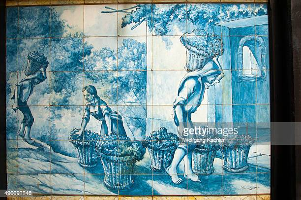 Portuguese tiles picturing the wine harvest in a winery in the city of Funchal on the Portuguese island of Madeira