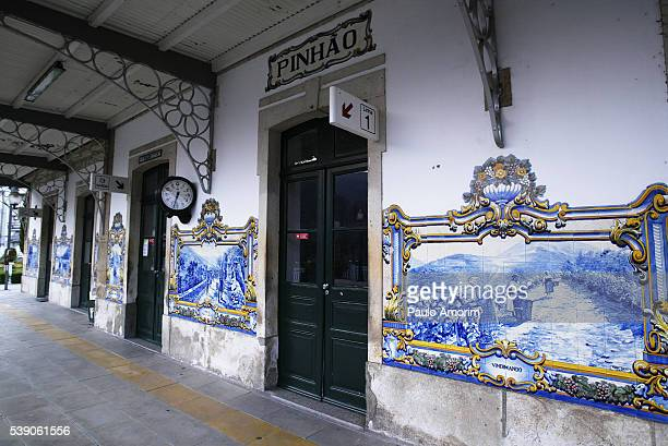 portuguese traditional tiles at railway station in portugal - douro valley stock photos and pictures