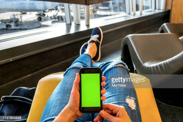 portuguese woman waiting in an airport - chroma key foto e immagini stock