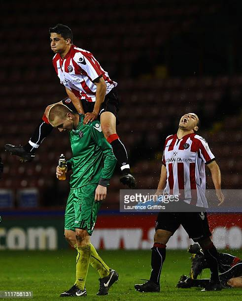 Porya Ahmadi of Sheffield United jumps on the shoulders of George Long as they celebrate victory in the FA Youth Cup Semi Fianal 2nd leg match beween...