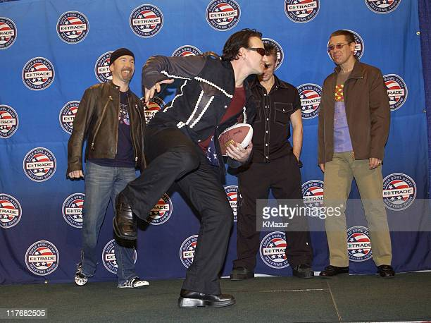 U2 pose for photographers January 30 2002 at a press conference at the Superdome in New Orleans Louisiana days before their live performance during...