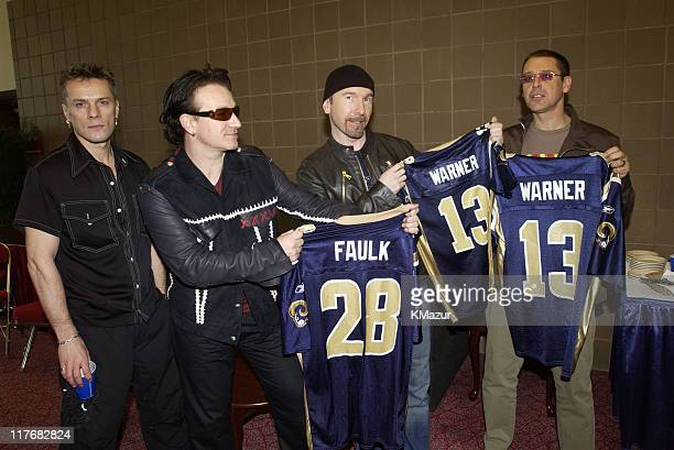 U2 pose for photographers January 30 2002 with customized New England Patriots jerseys at a press conference at the Superdome in New Orleans...