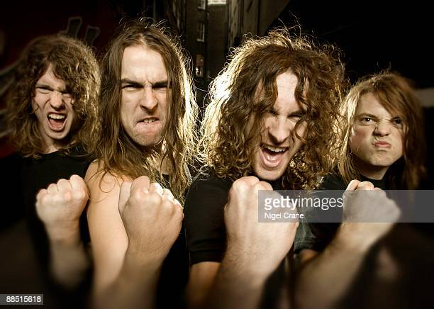 Posed group portrait of Australian rock band Airbourne Left to right are David Roads Ryan O'Keeffe Joel O'Keeffe and Justin Street in London England...