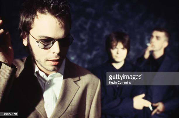 Posed group portrait of English group Supergrass in February 1997. Left to right are singer Gaz Coombes, bassist Mick Quinn and guitarist Danny...