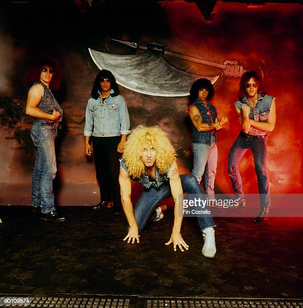 Posed group portrait of rock band Twisted Sister Left to right are Mark Mendoza Eddie Ojeda Dee Snider AJ Pero and JJ French taken in July 1982