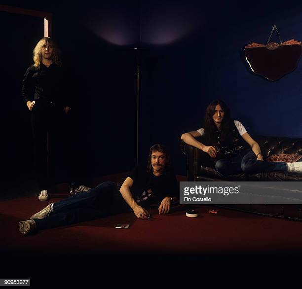 Posed group portrait of Rush Left to right are Alex Lifeson Neil Peart Geddy Lee in May 1979