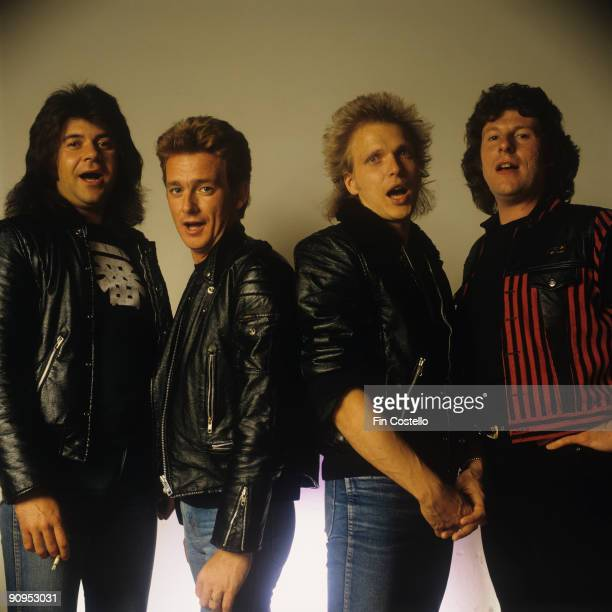 Posed group portrait of the Michael Schenker Group Left to right are Chris Glen Graham Bonnet Michael Schenker and Ted McKenna in 1982
