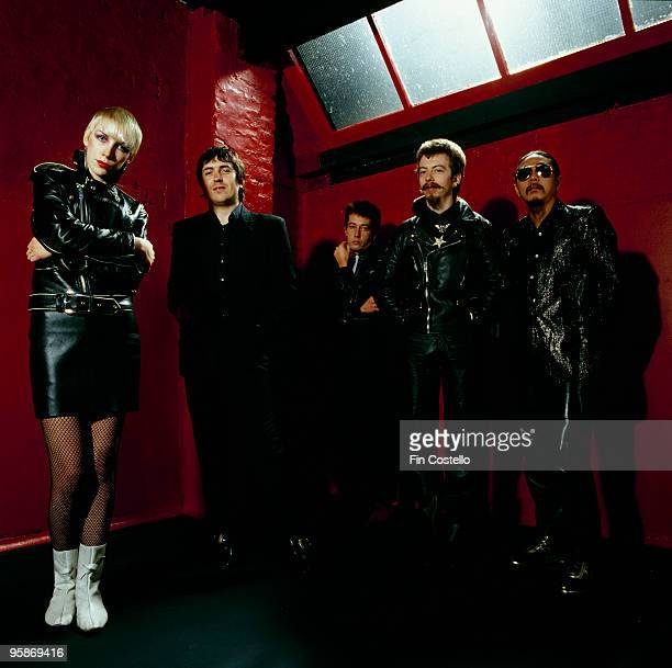 Posed group portrait of The Tourists. Left to right are Annie Lennox, Peet Coombes, Jim Toomey, Dave Stewart and Eddie Chin in 1980.