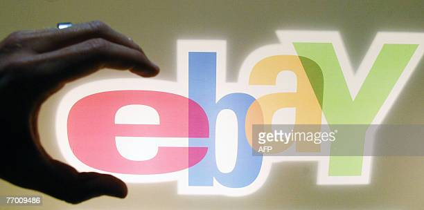 Posed photo shows a visitor grabbing the logo of internet auction house Ebay at the trade fair for digital marketing OMD 25 September 2007 in...