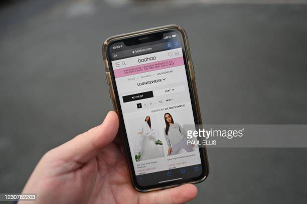 Posed photograph taken as an illustration in Lancaster, northwest England, on January 25, 2021 shows the website of fashion retailer Boohoo displayed...