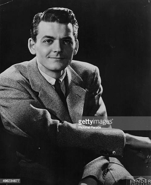 Posed portrait of actor Hal Holbrook wearing a suit and tie circa 1950