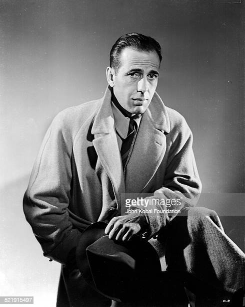 Posed portrait of actor Humphrey Bogart wearing an overcoat for Warner Bros Studios 1940