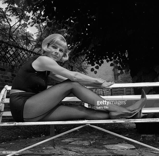 Posed portrait of actress Mary Peach wearing fishnet tights May 28th 1964