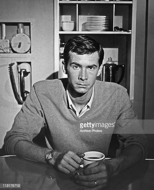 Posed portrait of American actor Anthony Perkins in a kitchen circa 1960