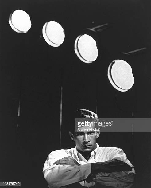 Posed portrait of American actor Anthony Perkins in front of studio lights circa 1960