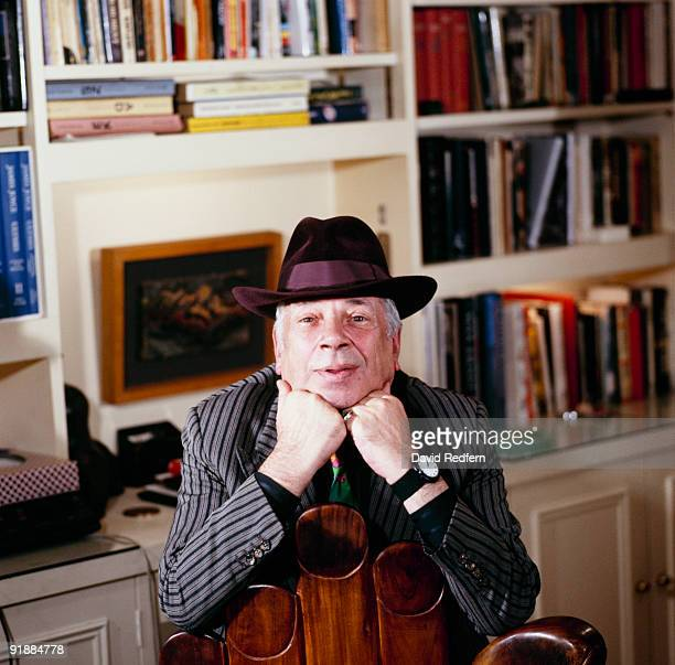 Posed portrait of jazz singer and writer George Melly at home in 1985
