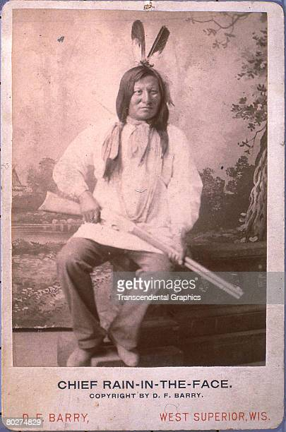 Posed portrait of Lakota Sioux Chief Rain-in-the-Face . Late 19th century. The photo, credited to D.F. Barry of West Superior, Wisconsin, features...