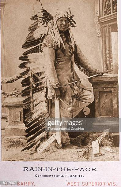 Posed portrait of Lakota Sioux Chief Rain-in-the-Face . Late 19th century. The photo, credited to D.F. Barry of West Superior, Wisconsin, features a...