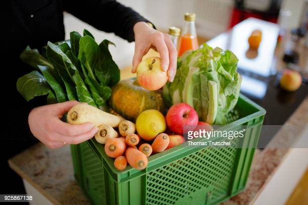 Posed Scene A vegetable box scheme with fresh organic fruit and vegetables stands in a kitchen on March 01 2018 in Berlin Germany