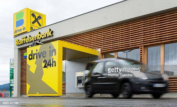 Posed scene car at a drivethrough of the Raiffeisenbank on August 24 in Zell am See Austria