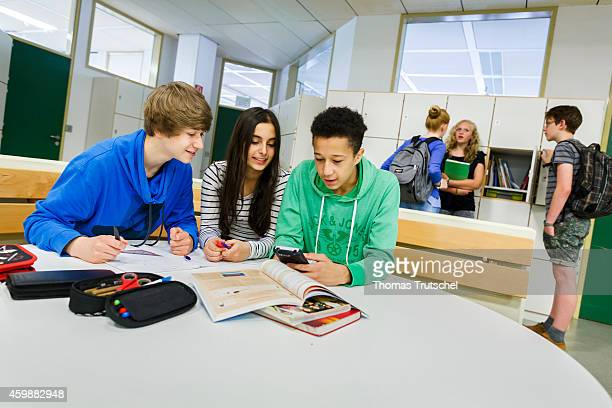 Posed scene group of students learning in a common room at the GeorgChristophLichtenbergGesamtschule IGS Goettingen on September 19 in Goettingen...