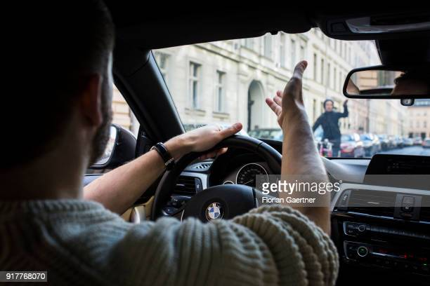 Posed scene of a cyclist and a car driver get excited about each other on February 13 2018 in Berlin Germany