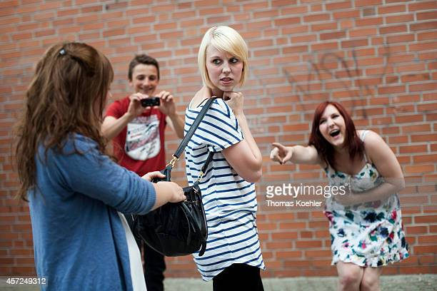 Posed scene of a girl being bullied by classmates on May 31 in Berlin Germany