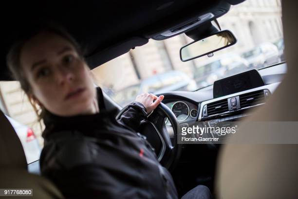 Posed scene of a woman who reserves into a parking space on February 13 2018 in Berlin Germany