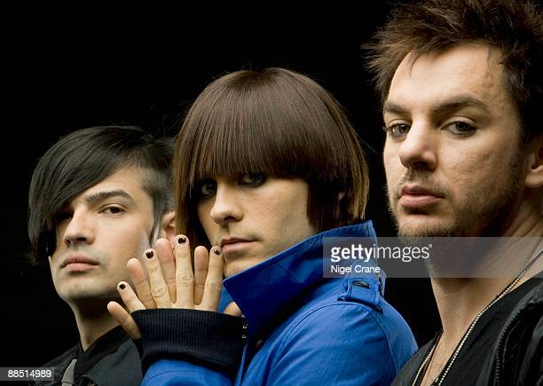 Posed studio group portrait of American rock band 30 Seconds to Mars Left to right are Tomo Milicevic Jared Leto and Shannon Leto London England on...