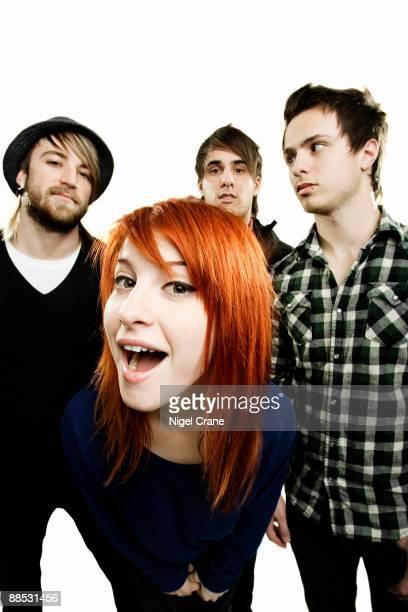 Posed studio group portrait of American rock band Paramore. Left to right are Jeremy Davis, Hayley Williams, Zac Farro and Josh Farro in London on...
