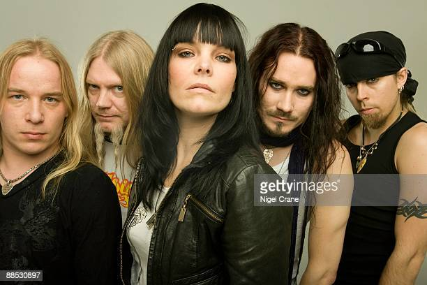 Posed studio group portrait of Finnish metal band Nightwish Left to right are Emppu Vuorinen Marco Hietala Anette Olzon Tuomas Holopainen and Jukka...