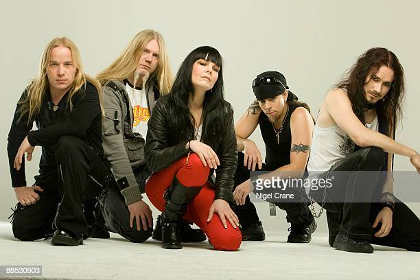 Posed studio group portrait of Finnish metal band Nightwish Left to right are Emppu Vuorinen Marco Hietala Anette Olzon Jukka Nevalainen and Tuomas...