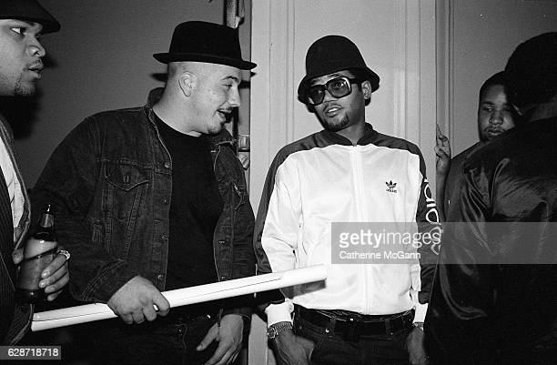 poses for a photo with friends at a party for the release of Run DMC's album 'Tougher Than Leather' on September 15 1988 at the Palladium night club...