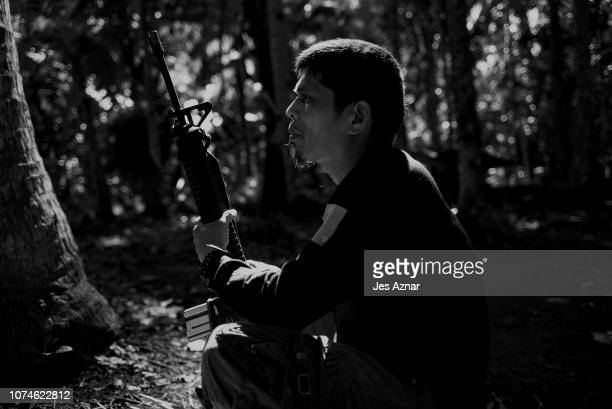 JL poses for a portrait inside an NPA camp on December 11 2018 in a remote village in the Bicol region Philippines JL was a poor farmer but has been...