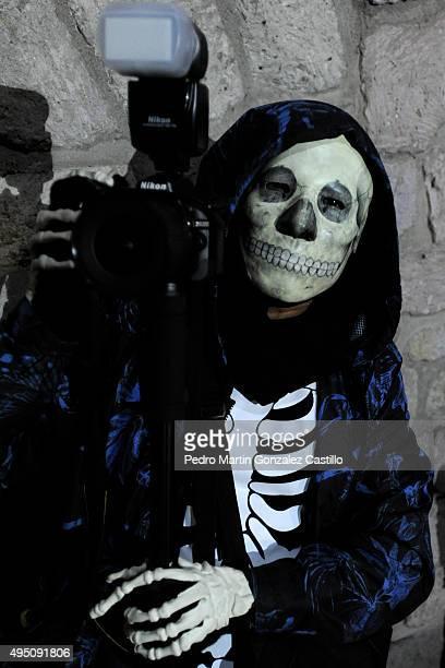 poses for pictures during the Catrinas contest as part of Day of the Dead celebration at Colegio Primitivo Nacional de San Nicolás de Hidalgo Morelia...