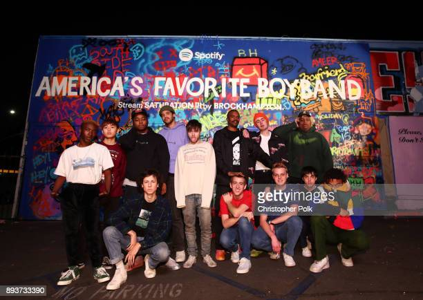 BROCKHAMPTON poses in front of the finished mural at BROCKHAMPTON and Spotify host an event for their biggest fans to celebrate the launch of their...