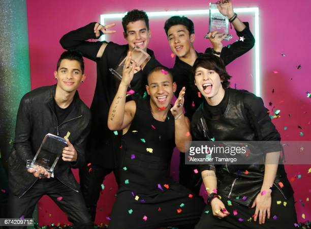 CNCO poses in the press room during the Billboard Latin Music Awards at Watsco Center on April 27 2017 in Coral Gables Florida