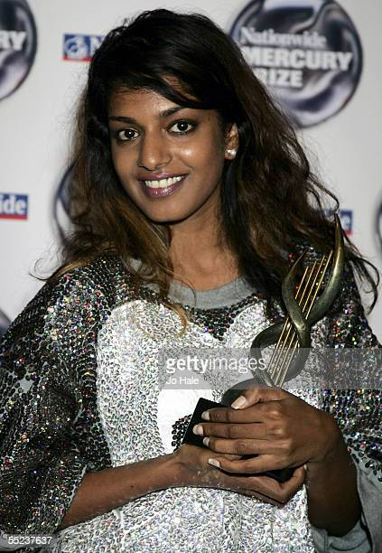 A poses in the pressroom with the award for nomination at the annual Nationwide Mercury Prize music awards ceremony at Grosvenor House on September 6...