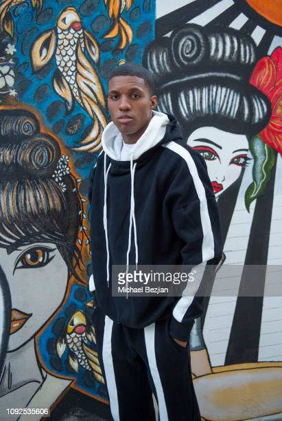JAY poses with Gracie Kim Art work wearing Fashion Nova at Giveback Day at TAP The Artists Project on January 10 2019 in Los Angeles California