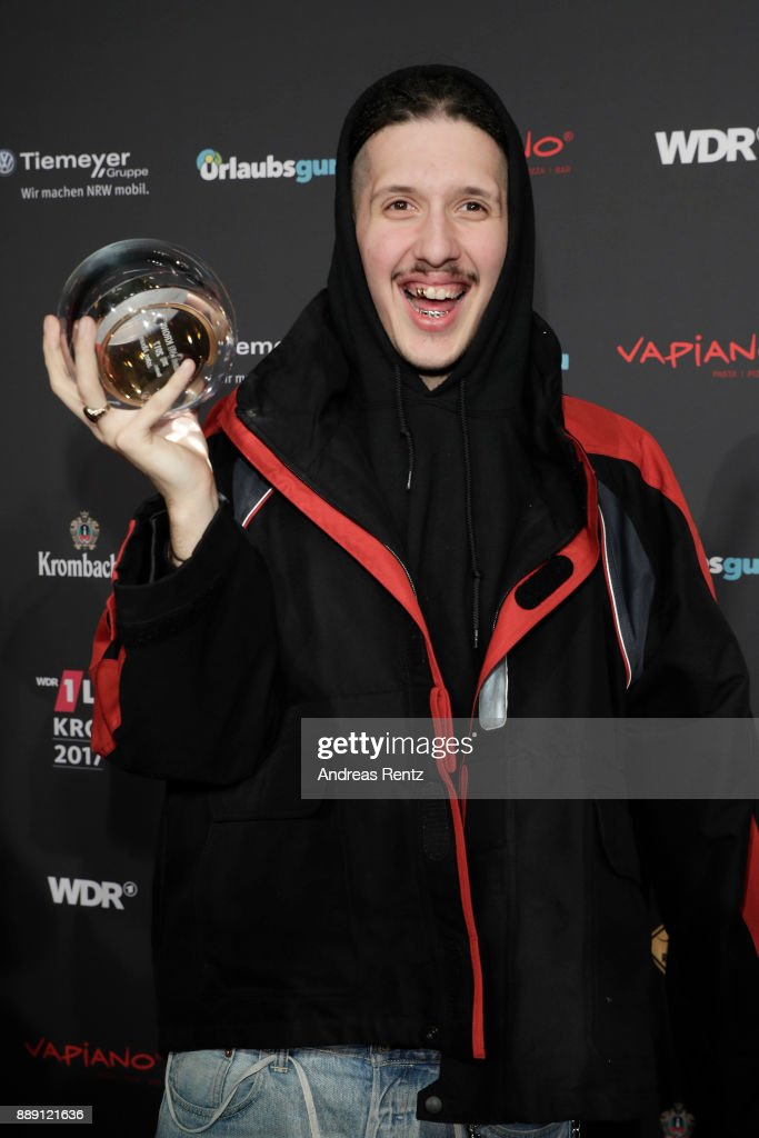 RIN poses with his award during the 1Live Krone radio award at Jahrhunderthalle on December 07, 2017 in Bochum, Germany.