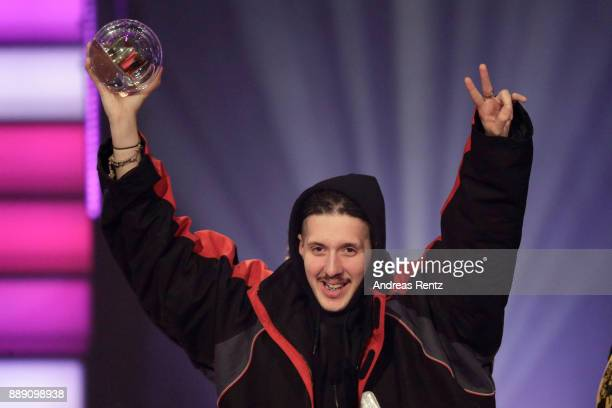 RIN poses with his award for best album on stage during the 1Live Krone radio award at Jahrhunderthalle on December 07 2017 in Bochum Germany