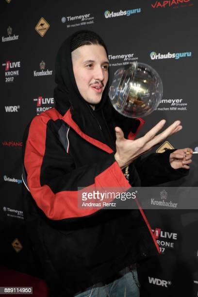 RIN poses with his awards during the 1Live Krone radio award at Jahrhunderthalle on December 07 2017 in Bochum Germany