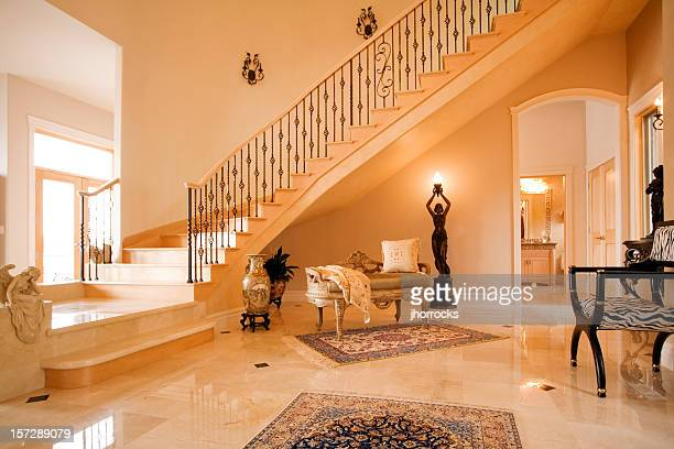 posh entry with spiral staircase - stately home stock pictures, royalty-free photos & images