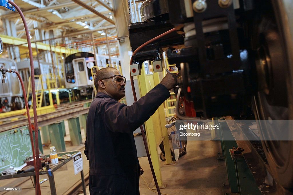 Posh Ramsunder works on the trucks of a Kawasaki R160 train